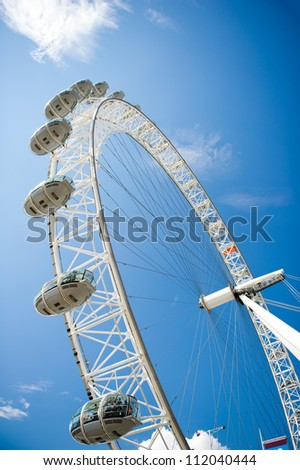 LONDON - AUG 6: The London Eye on August 6, 2012 in London. The entire structure of the London Eye is 135 meters tall and the wheel has a diameter of 120 metres. - stock photo