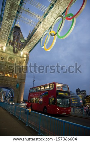 LONDON - AUG 6, 2012. Tower Bridge at night with Olympic rings during London 2012 Olympic Games in London on August 6, 2012. Tower Bridge, One of the most famous bridges in the world. - stock photo