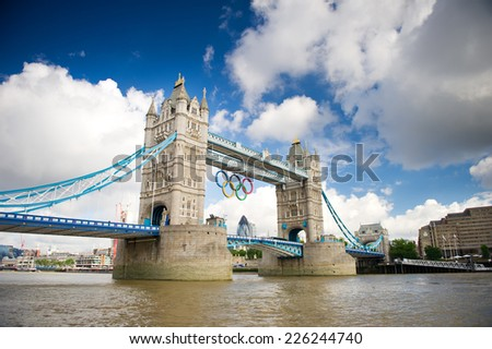 LONDON - AUG 6: Tower Bridge with Olympic rings during London 2012 Olympic Games in London on August 6, 2012. Tower Bridge, One of the most famous bridges in the world. - stock photo