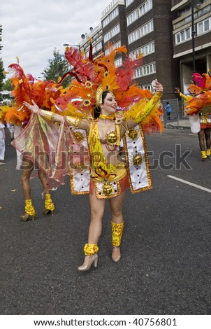 LONDON - AUGUST 31: A dancer from the Paraiso School of Samba float during the Notting Hill Carnival August 31, 2009 in London, England. - stock photo