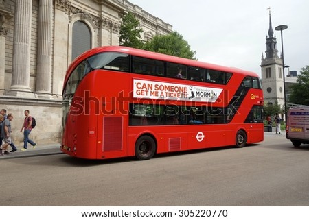 LONDON - AUGUST 11: A London bus at St Paul's, London. London buses are increasingly fuel efficient. August 11, 2015 in London.