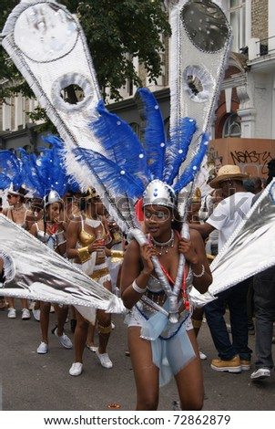 LONDON - AUGUST 30: A woman takes part in the parade at the Notting Hill Carnival on August 30, 2010 in London