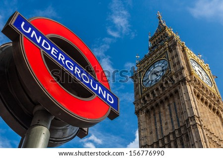 LONDON - AUGUST 7: Big Ben Clock and London Underground station sign on August 7, 2013. The London Underground is the oldest metropolitan railway in the world, dating from 1863. - stock photo