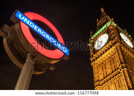 LONDON - AUGUST 6: Big Ben Clock and London Underground station sign on August 6, 2013. The London Underground is the oldest metropolitan railway in the world, dating from 1863. - stock photo