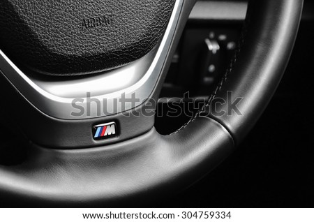 LONDON - AUGUST 10: BMW M Sport badge on the steering wheel. August 10, 2015 in London, UK. - stock photo