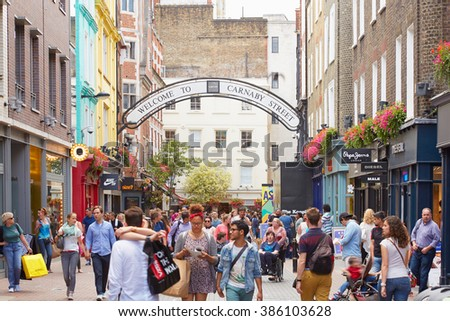 LONDON - AUGUST 6: Carnaby street, famous shopping street with people on August 6, 2015 in London. The street is located in Soho district, near Oxford street and Regent street. - stock photo