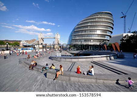 LONDON - AUGUST 26. City Hall, the Mayor of London's headquarters, designed by Foster and Partners, with Tower Bridge beyond on August 26, 2013, in the Borough of Southwark, London, UK.