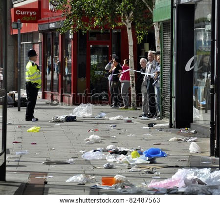 LONDON - AUGUST 09: Clapham Junction area is sacked after the third night of riots, on August 09, 2011 in London. Riots start spreading in London after Mark Duggan was shot dead by the police. - stock photo