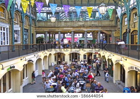 LONDON, AUGUST 4, 2010: Covent Garden Market. One of the main London attractions, Covent Garden was for many years the main fruit and vegetables market in London - stock photo