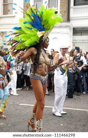 LONDON - AUGUST 27: Dancers at the annual Notting Hill Carnival on August 27, 2012 in Notting Hill, London.