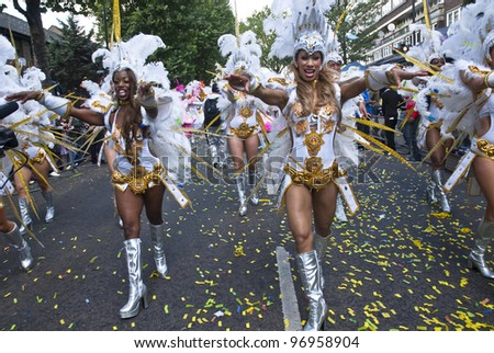 LONDON - AUGUST 30: Dancers from the Paraiso School of Samba float at the Notting Hill Carnival on August 30, 2010 in Notting Hill, London. - stock photo