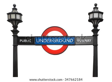 LONDON - AUGUST 6, 2015: Famous London public underground subway sign with street lamps on white, clipping path. The tube logo was registered as a trademark in 1917 on August 6, 2015 in London. - stock photo