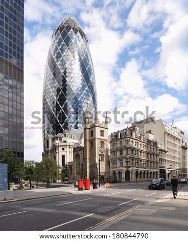 LONDON - AUGUST 10. Informally known as The Gherkin, 30 St Mary Axe is a 180 metre (591 feet) building designed by Foster and Partners; August 10, 2013 in the financial district of London, UK.  - stock photo