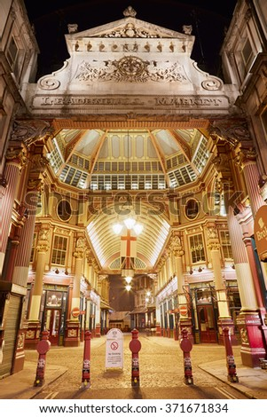 LONDON - AUGUST 9 : Leadenhall covered market interior entrance at night on August 9, 2015 in London, UK. The market dates dates the 14th century and is located in the City of London. - stock photo
