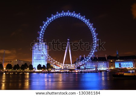 LONDON - AUGUST 3: Night shot of the London Eye on August 3, 2012 in London. The London Eye is a giant Ferris wheel situated on the banks of the River Thames. The entire structure is 135 m tall. - stock photo