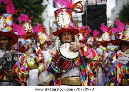 LONDON - AUGUST 29: Performers take part in the second day of Notting Hill Carnival, largest in Europe, on August 29, 2011 in London, UK. Carnival takes place over two days in every August. - stock photo