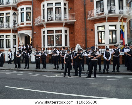 LONDON - AUGUST 19: Police Watch Julian Assange Protest Outside The Ecuadorian Embassy London August 19th, 2012 in London, England. - stock photo
