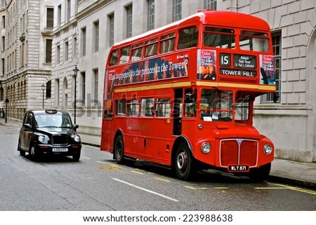LONDON - AUGUST 10: Routemaster Bus operating in London on August 10, 2011 in London, UK. The open platform facilitated speedy boarding under the supervision of a conductor.