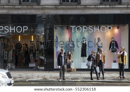 LONDON - August 27, 2016: Showcase store Top Shop on the Strand. People stand near the windows.