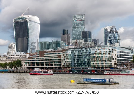 LONDON -AUGUST 6: The City of London on August 6, 2014 in London. The City of London is the main financial district of London and vies with New York City as the financial capital of the world - stock photo
