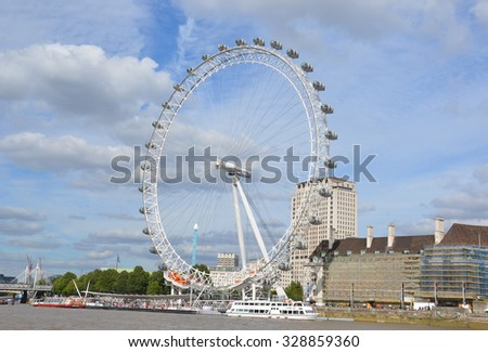 LONDON - AUGUST 6: The 135-meter tall Coca-Cola London Eye, shown on August 6, 2015, is the largest cantilevered observation wheel in the world.  - stock photo