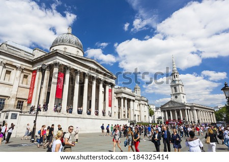 LONDON - AUGUST 20: The National Gallery at Trafalgar Square in London with blue sky and tourists passing by on August 20, 2013 - stock photo