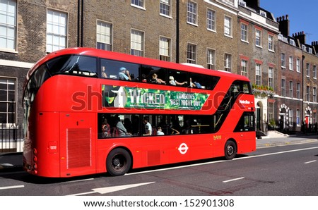 LONDON - AUGUST 31. The new London Routemaster diesel-electric hybrid double deck bus with three doorways and two staircases accommodates 80 passengers; August 31, 2013, in Bloomsbury, London, UK. - stock photo
