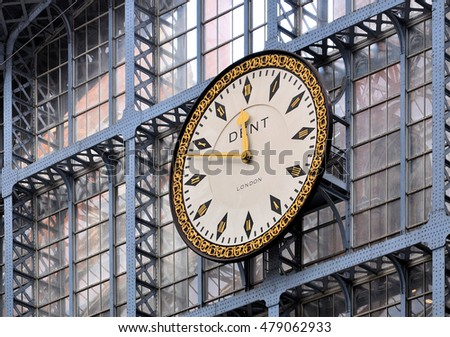 LONDON - AUGUST 16, 2016. The platform clock is an authentic replica of the original 18 ft (5.5m) diameter 1868 design by Dent, the original manufacturer, at St Pancras railway station in London, UK.