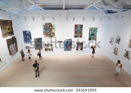 LONDON - AUGUST 8, 2015: Visitors at art exhibition at the Saatchi Gallery in Chelsea on August 8, 2015 in London, UK. The gallery is now located in the Duke of York Headquarters Building. - stock photo