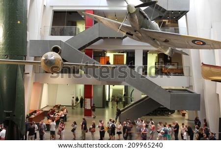 LONDON - AUGUST 1: Visitors viewing exhibits in the atrium of the newly refurbished Imperial War Museum on August 1, 2014 in London, UK - stock photo