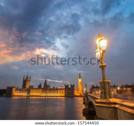 London. Beautiful sunset across Westminster Bridge with Houses of Parliament on background.