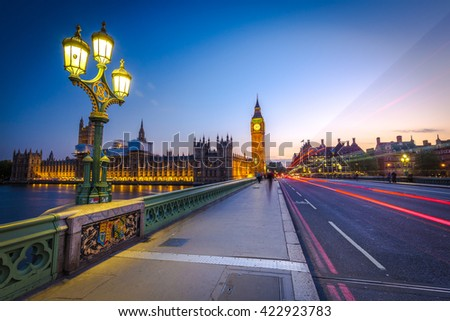 London Big Ben and traffic on Westminster Bridge in United KIngdom.