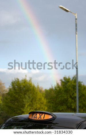 London Black Taxi Cab and Rainbow - stock photo