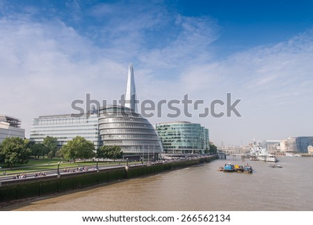 London buildings along river Thames. - stock photo