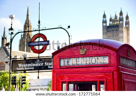 London-circa October 2013 : red telephone box and Westminster metro station. The houses of Parliament in the background. - stock photo