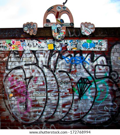 London-circa October 2013 - urban graffiti near Phipp Street. The work is a realistic portrait of a toy looking down - stock photo