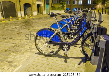 "London City Bike Rental - Stock Image. Row of bikes for hire as part of a new scheme to encourage ""pedal power"" in the City of London.  - stock photo"