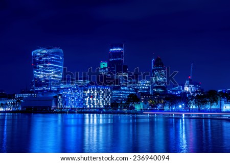 London city skyline from the River Thames by night - stock photo
