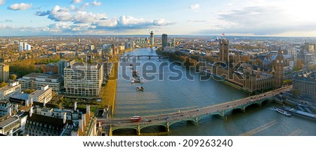 LONDON CITY : The London Eye, erected in 1999, is a giant (135mt.) ferris wheel situated on the banks of the river thames. Is the most popular attraction of the UK. APRIL 20, 2012 in London, UK. - stock photo