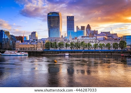 London cityscape during sunrise with its reflection from river Thames.