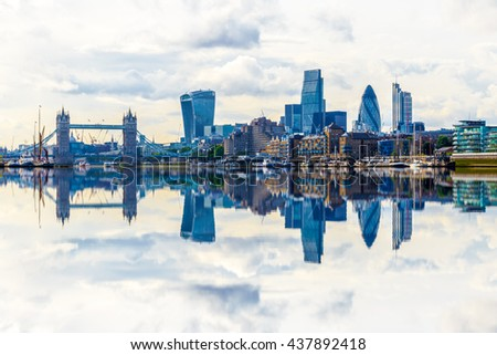 London cityscape with dramatic clouds with its reflection from river Thames - stock photo