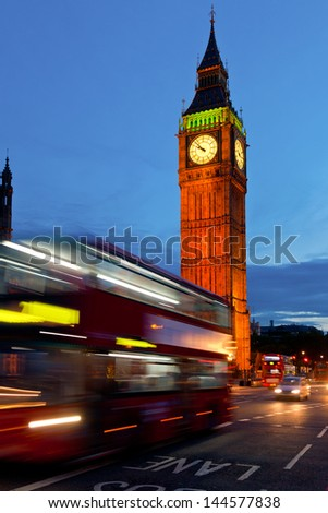 London cityscape with Elizabeth Tower and moving Double Decker buses - stock photo