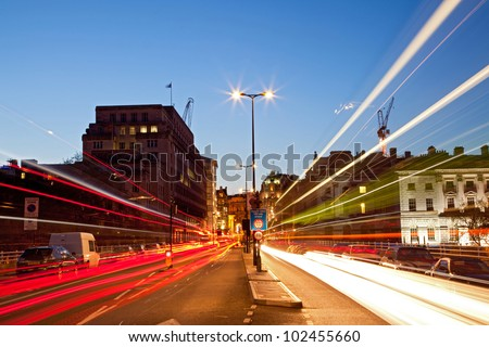 London Cityscape with Road Light Trail at dusk using for City Lifestyle transportation - stock photo