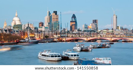 London Cityscape with St Paul's Cathedral and River Thames England UK at dusk - stock photo