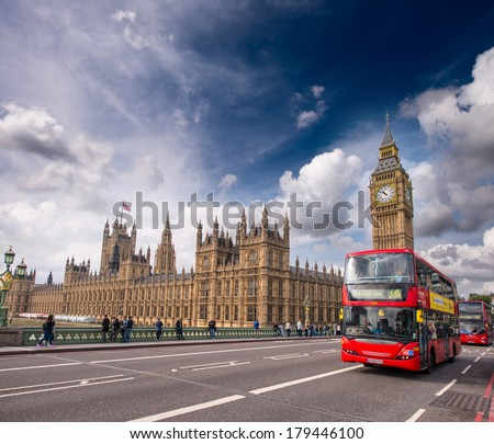 London. Classic Red Double Decker Buses on Westminster Bridge. - stock photo