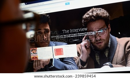 LONDON - DEC 25: A viewer browses Google Play store for the Sony Pictures film The Interview on Dec 25, 2014 in London, UK. The controversial film has seen limited online and cinema release in the US. - stock photo