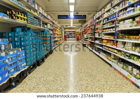 LONDON - DEC 12: Aisle view of a Tesco supermarket on Dec 12, 2014 in London, UK. Britain's Tesco is the world's third largest supermarket after America's Walmart and France's Carrefour. - stock photo