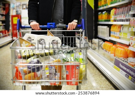 LONDON - DEC 12: Aisle view of a Tesco supermarket store on Dec 12, 2014 in London, UK. Britain's Tesco is the world's third largest supermarket chain after America's Walmart and France's Carrefour. - stock photo