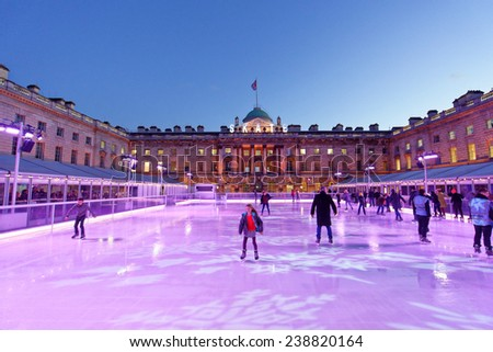LONDON - DEC. 14 : ice skating Christmas rink pictured on December 14th, 2014, in London, England. The ice skating rink at Somerset house opens every year in December at Christmas time in London.  - stock photo