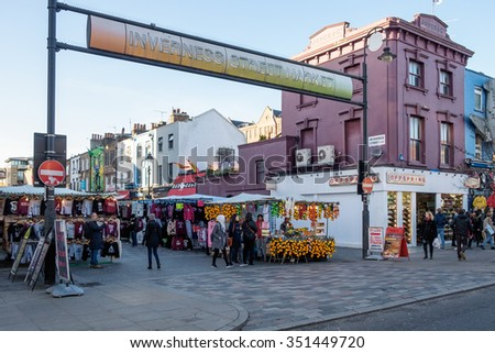 LONDON - DEC 9 : Inverness Street Market at Camden Lock in London on Dec 9, 2015. Unidentified people. - stock photo
